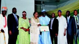 NUC 12: Officials of Hallmark University, Ijebu-Itele, Ogun State, displaying their license with Education Minister, Mallam Ibrahim Shekarau (middle), Minister of State for Education, Prof. Viola Onwuliri (3rd from left), Executive Secretary, National Universities Commission, Prof. Julius Okojie (3rd from right) at the event.