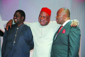 Managing Director/Editor-in-Chief of The Sun newspaper, Mr Femi Adesina (left), Secretary to the Federal Government, Pius Anyim and outgoing Governor of Akwa Ibom State, Godswill Akpabio (right) at an event.