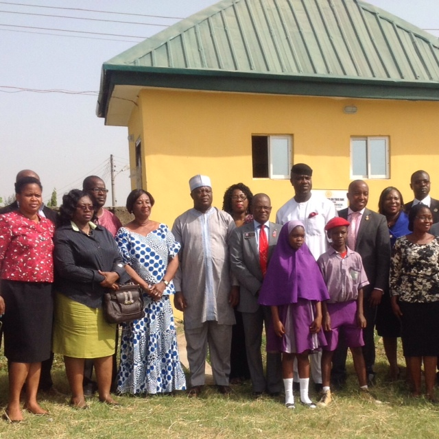 Head Teacher, Local Government Education Authority (LGEA) Primary School, Malam Shuaibu Usman (4th from left, front row), District Governor, Rotary District 9125, Tolu Omatsola, District Governor Elect, Dr. Mike Omotosho (wearing a black cap), Rotarians, teachers and students during the recent commissioning of a four-unit toilet facility donated by the Rotary Club of Abuja