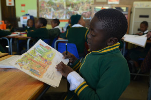 A student with a book at Carter Primary School, in Alexandra, Johannesburg, South Africa. PHOTO: EVA-LOTTA JANSSON
